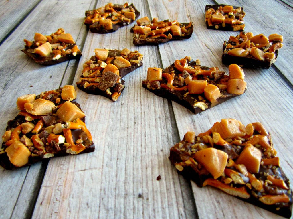 Rich, dark chocolate, covered in caramel pieces, toffee bits, and pretzels creates this smooth and luscious Caramel Toffee Chocolate Bark.
