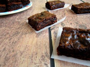 scattered brownies with a plate in the background