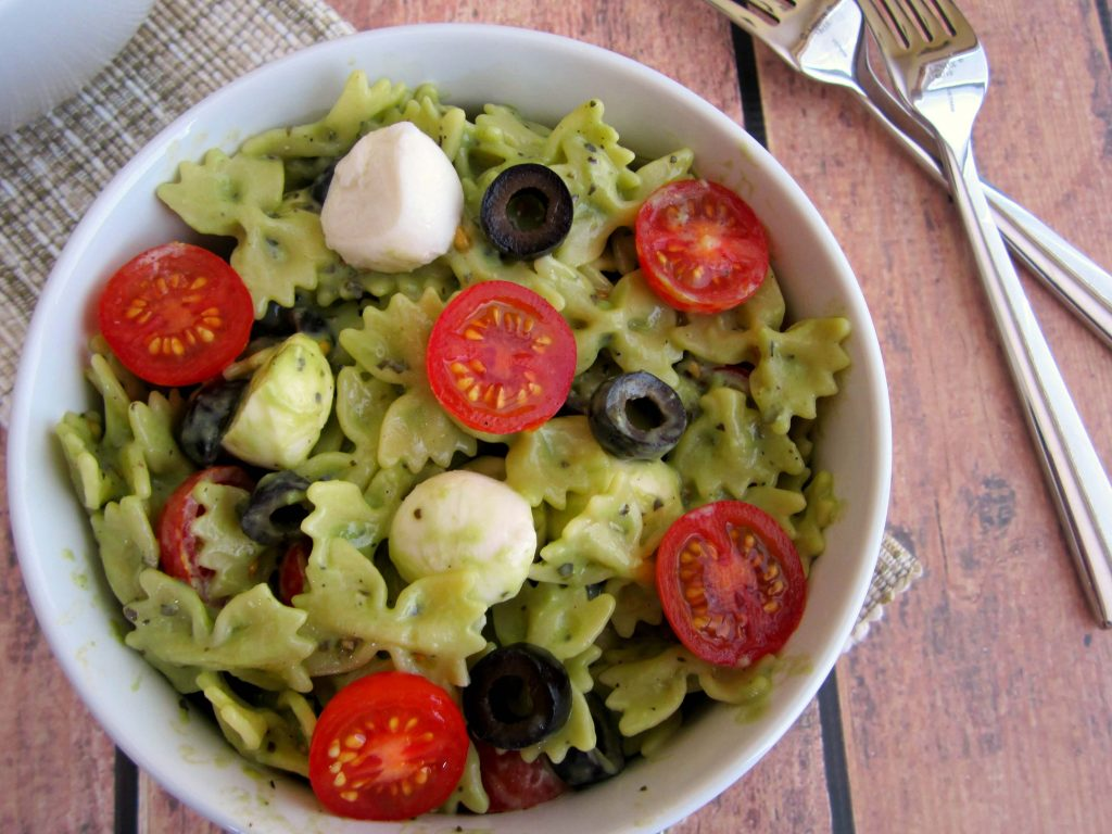 Creamy Parmesan basil pesto, tossed with fresh pasta, tomatoes and mozzarella cheese creates this zesty Pesto Mozzarella Pasta Salad!