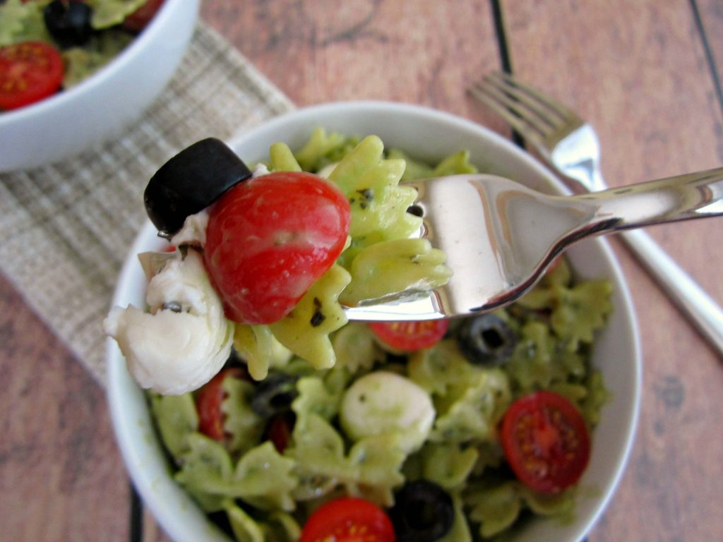 Creamy Parmesan Basil Pesto Tossed With Fresh Pasta Tomatoeozzarella Cheese Creates This