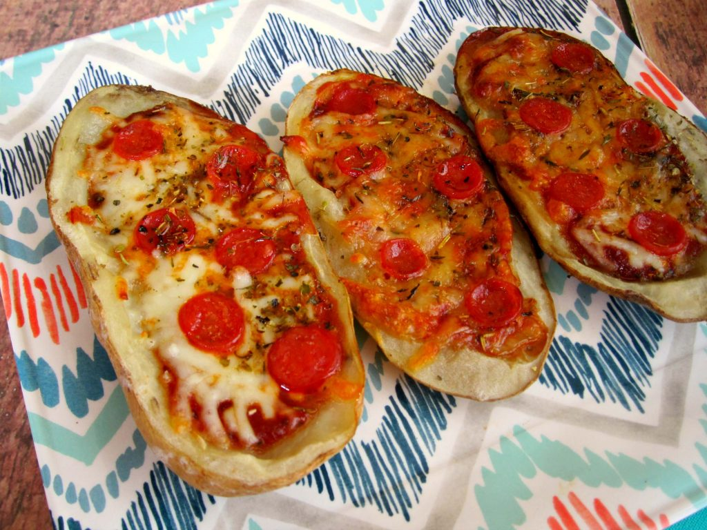 Loaded with pizza sauce, fresh mozzarella cheese, pepperoni, and seasonings, these Pizza Potato Skins are sure to be a crowd-pleasing appetizer or snack!