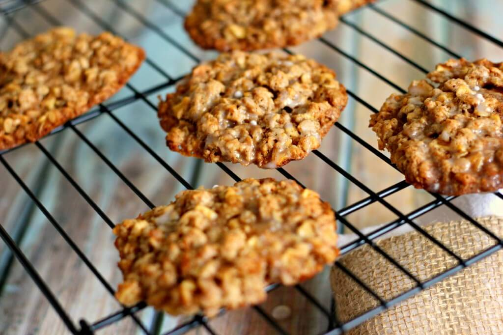 These Glazed Apple Oatmeal Cookies are filled with apple chunks, spices, and topped with a deliciously sweet glaze.