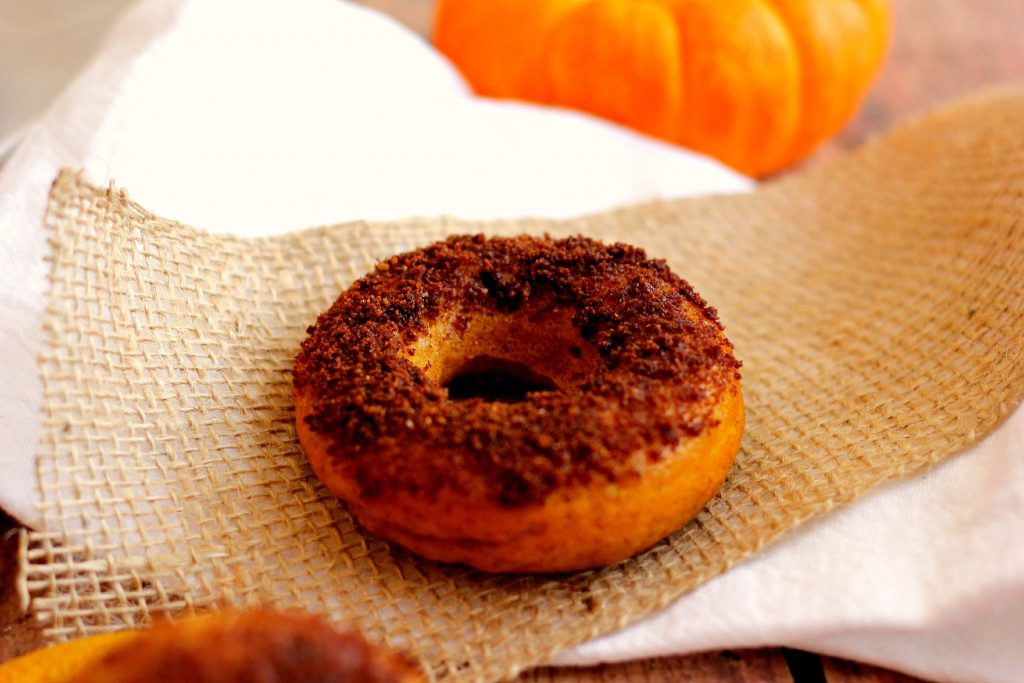 If you love pumpkin baked goodies, then you'll flip over these Pumpkin Cake Donuts with Salted Caramel Brownie Brittle Topping. #doughnuts #pumpkin #pumpkindoughnuts #donuts #pumpkindonuts #pumpkinnspice