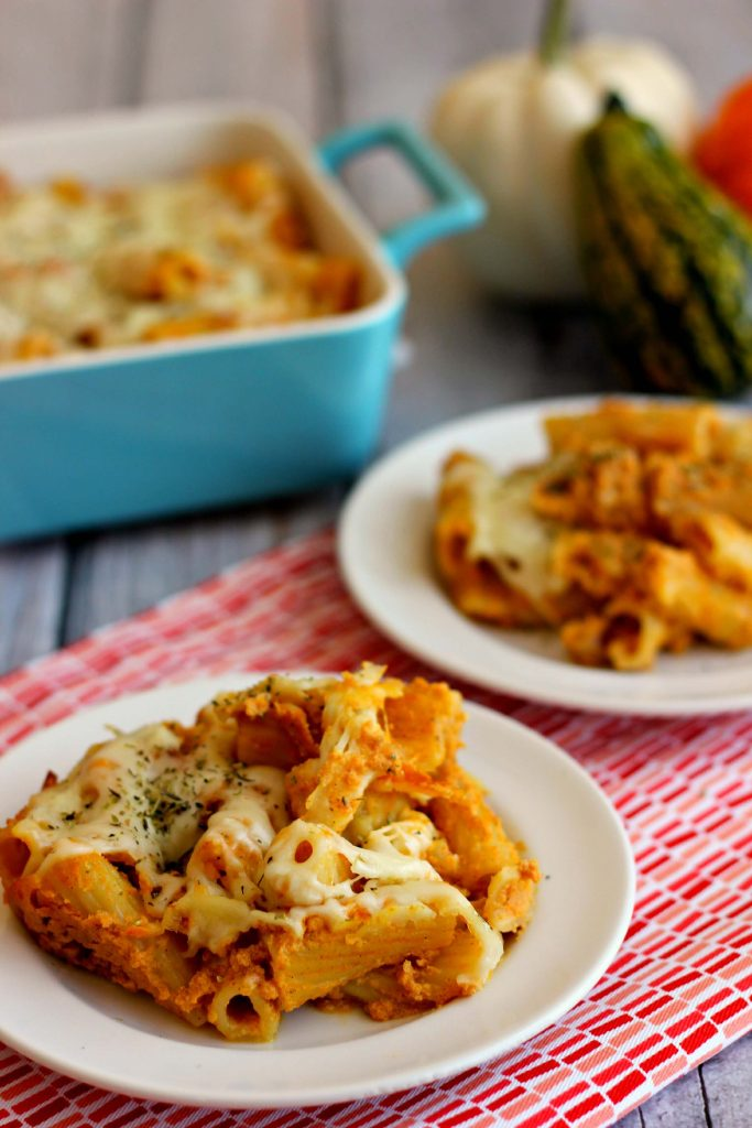 Pumpkin is not just for dessert anymore! Cheesy Pumpkin Pasta Bake is full of rigatoni noodles, covered in creamy pumpkin mixture, and enveloped with ricotta and mozzarella cheeses. Creamy, comforting and the perfect fall dinner! #pumpkin #pasta #fallrecipes #comfortfood #pumpkinnspice