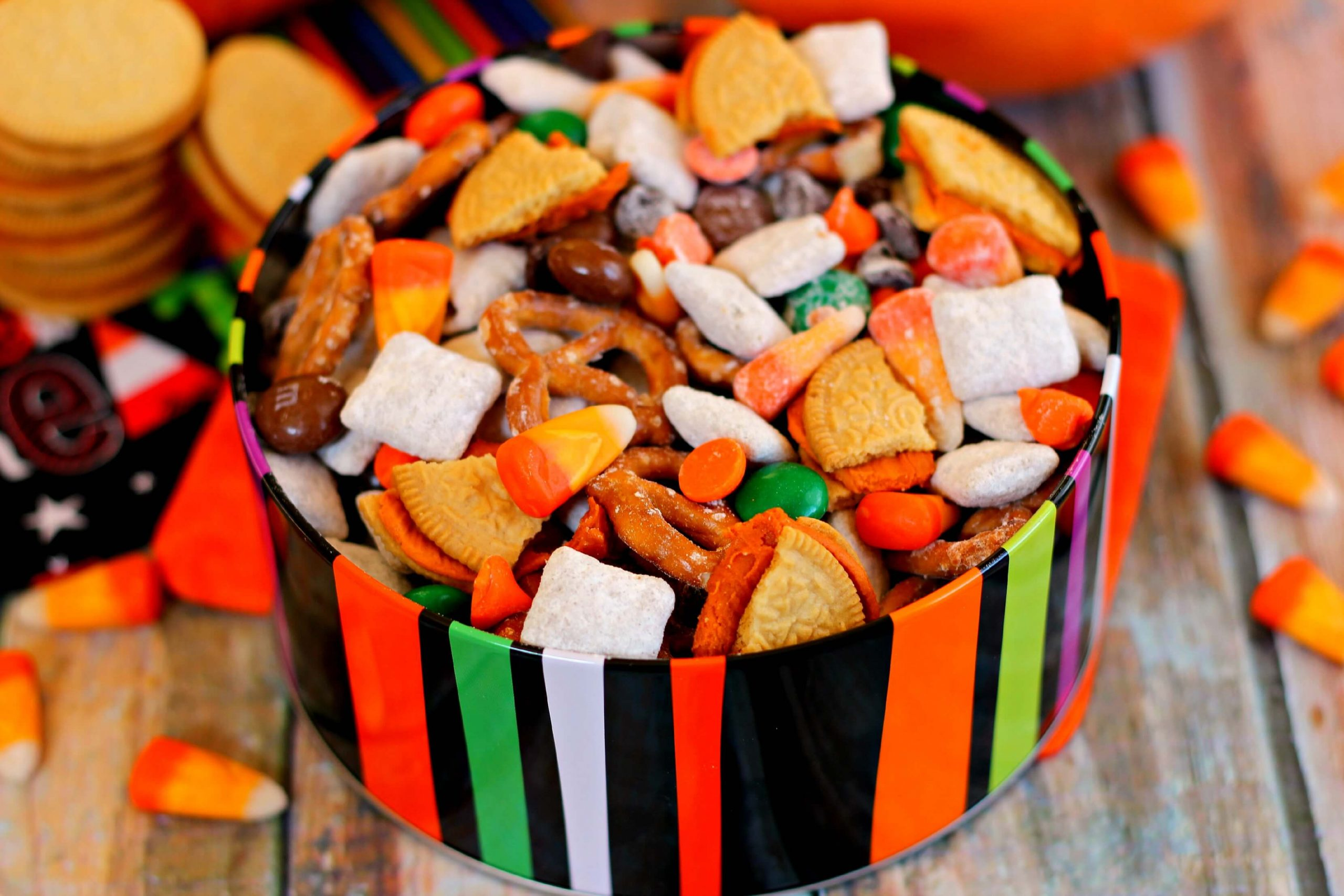 This Halloween Snack Mix is full of tasty treats, such a chex cereal coated with pumpkin spice pudding mix, pretzels, Pumpkin Spice Oreos, pumpkin spice candy corn, pumpkin spice M&Ms, and Halloween chocolate chips. Basically, it's pumpkin spice flavored goodies in a bowl!