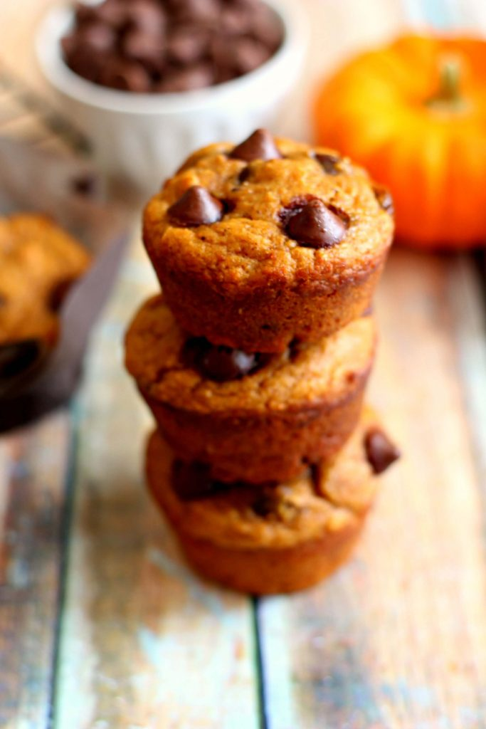 These Whole Wheat Pumpkin Muffins with chocolate chips are filled with cozy fall flavors for a fraction of the calories that you would find in a regular bakery shop muffin. #pumpkinnspice #muffins #pumpkin #healthymuffins #pumpkinbreakfast #wholewheatmuffins