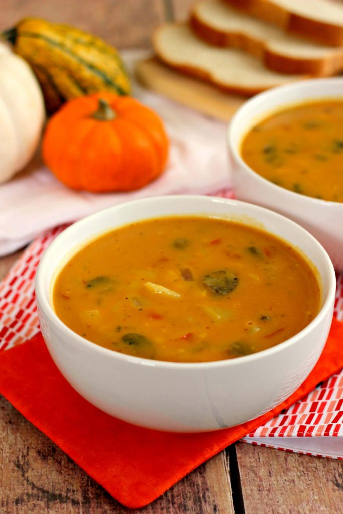 This Creamy Pumpkin Soup is full of pumpkin flavor, filled with vegetables, and healthy. The base of the soup comes from low-fat chicken broth, skim milk, and pumpkin puree. Low in calories and full of flavor, you'll never guess that this soup is healthy! #soup #souprecipe #pumpkin #pumpkinsoup #pumpkinsouprecipe #fallrecipe #fallsoup #fallsouprecipe #falldinner