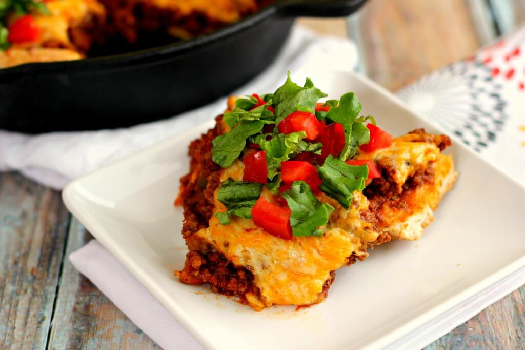 This Easy Taco Bake contains a buttery pizza crust, filled with a salsa ground beef mixture, and topped with cheese.