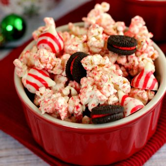 This White Chocolate Candy Cane Popcorn is coated with white chocolate and tossed with candy cane Oreos and candy cane kisses to provide a tasty snack.