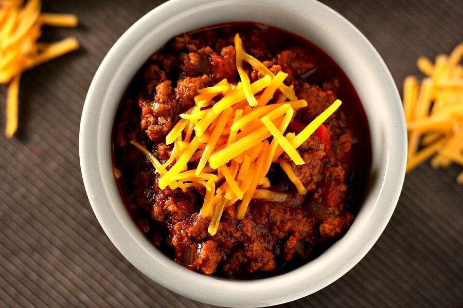 Made with two types of ground beef and loaded with flavor, you'll never miss the beans in this Slow Cooker Hearty No-Bean Chili!