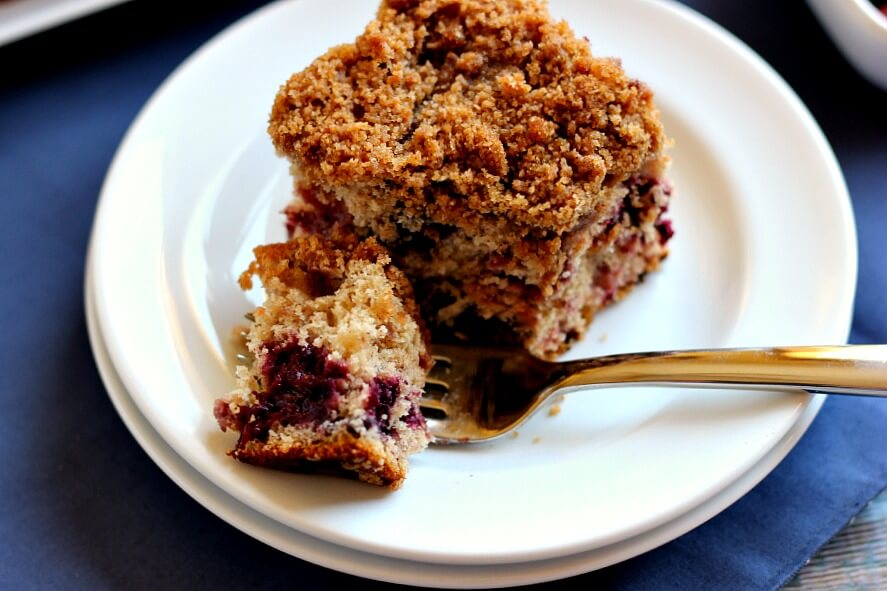 Bursting with strawberries, blueberries, blackberries, and raspberries, this Mixed Berry Coffee Cake is moist and light, with cinnamon sprinkled in.