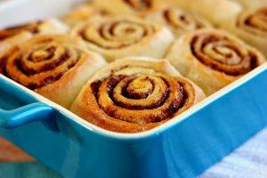 cinnamon rolls in a blue dish