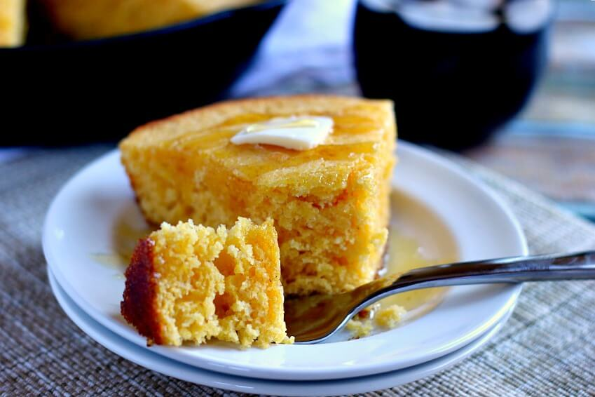 This Skillet Buttermilk Cornbread is soft, moist, and contains a buttery crust, perfect for munching on for breakfast or dinner.
