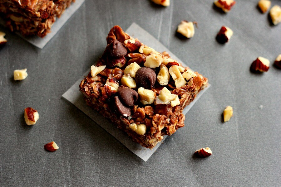 Jam-packed with chocolate, peanut butter, hazelnuts, and coconut oil, these squares come together in minutes and are an easy, no-bake treat.