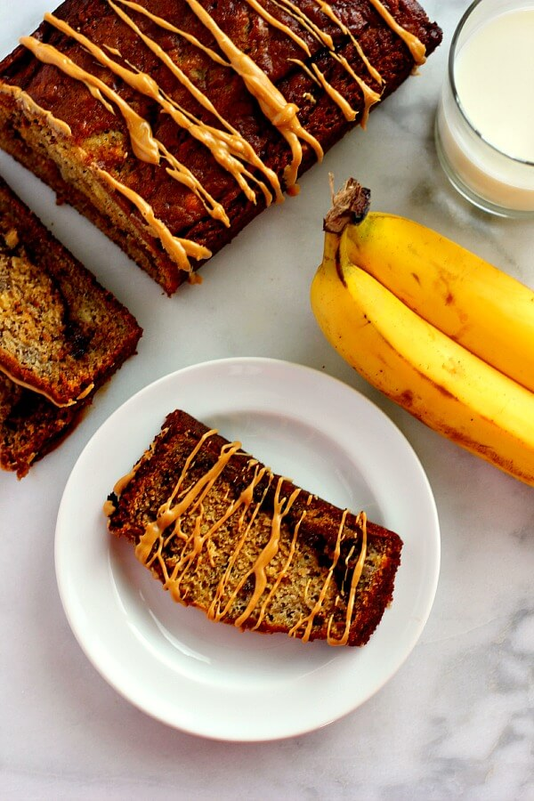 This Peanut Butter Cup Banana Bread is moist, full of flavor, and swirled with Reese's Peanut Butter Spread.