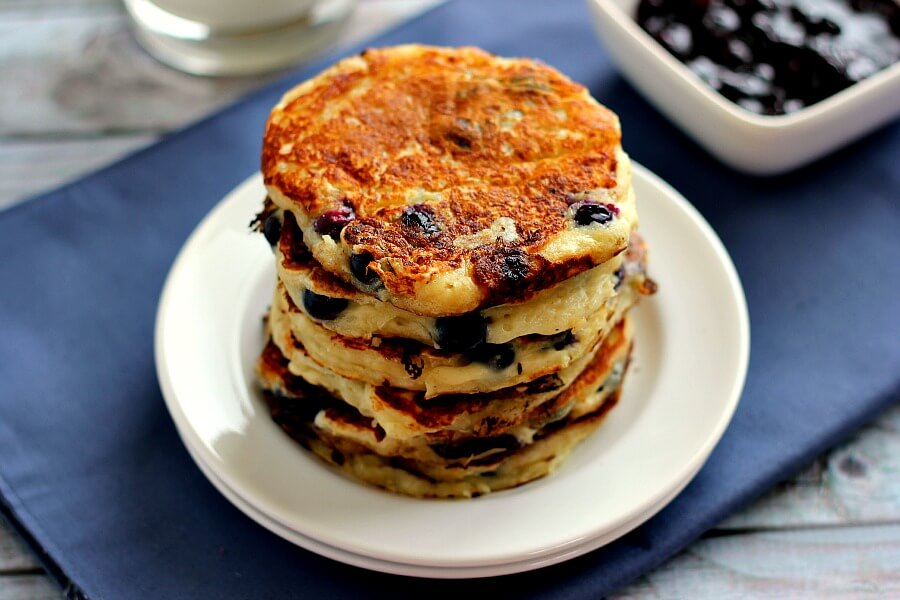 Light, fluffy, and bursting with fresh blueberries, these Blueberry Greek Yogurt Pancakes are the ultimate treat for when you want to indulge in a healthier breakfast.
