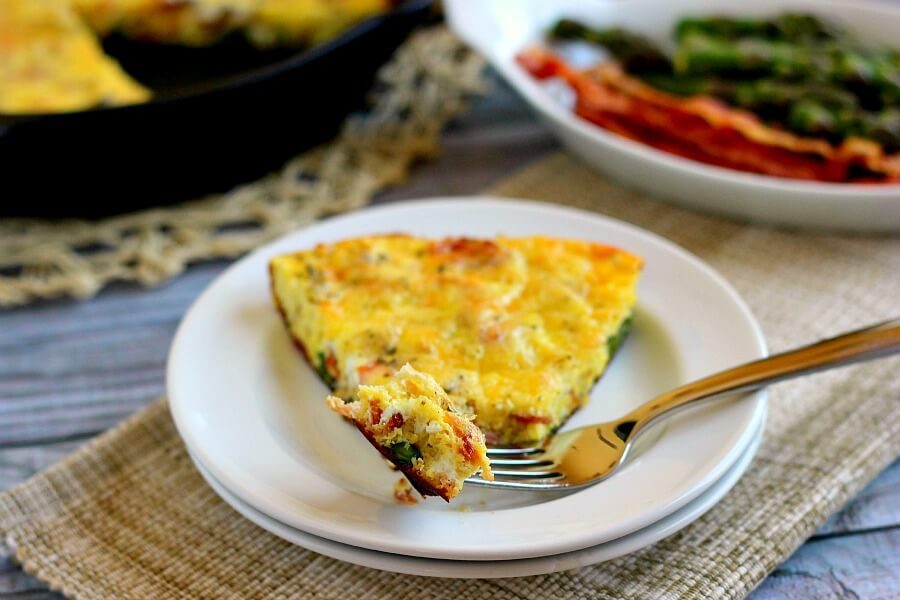 This Asparagus and Bacon Frittata is full of flavor and doubles as a quick and easy breakfast or tasty weeknight meal!
