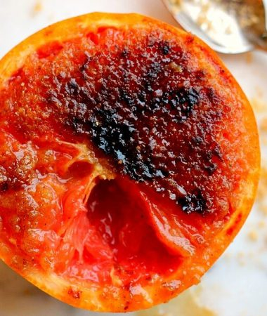 Loaded with flavor, this Caramelized Brown Sugar Grapefruit is broiled to perfection, resulting in a sweet and tangy treat that will tickle your taste buds!