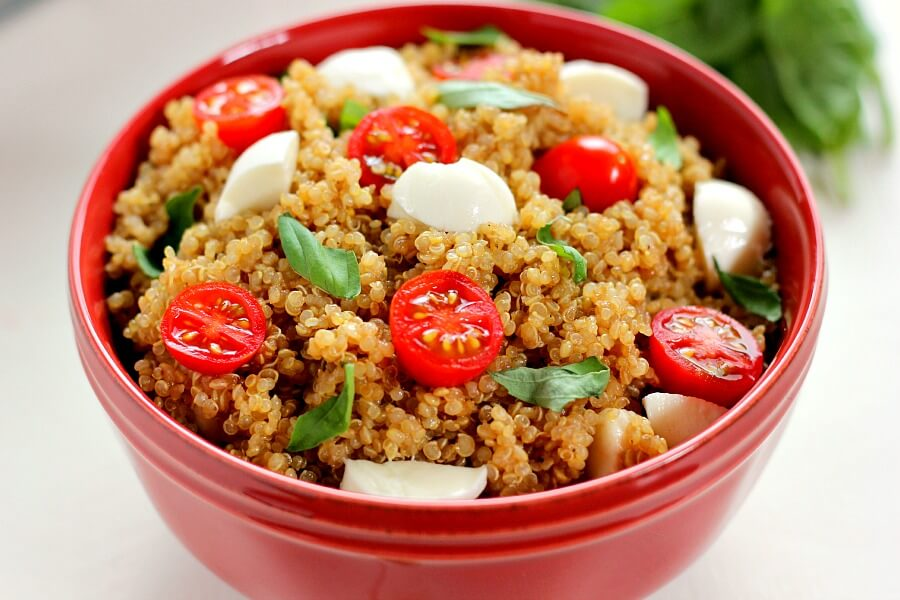Filled with hearty quinoa, fresh tomatoes, creamy mozzarella, and basil, this Quinoa Caprese Salad combines the classic flavors into a healthier dish. It's easy to make, packed with protein, and is bursting with flavor!