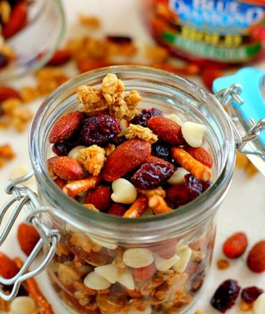 Filled with Sriracha Blue Diamond Almonds, crunchy granola, pretzels, dried cranberries, and white chocolate, this Sweet and Spicy Trail Mix has the perfect combination of sweet and spicy ingredients!