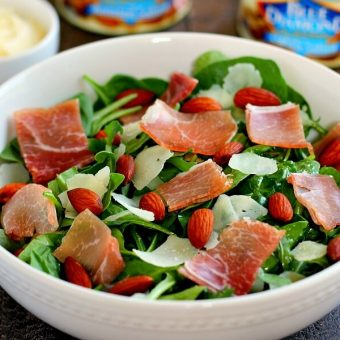 Packed with fresh arugula, salty prosciutto, roasted almonds and tossed in a light olive oil dressing, this Arugula and Prosciutto Almond Salad is light, refreshing and full of nutrients. It makes a delicious lunch on-the-go or a light dinner for those warm, summer nights!