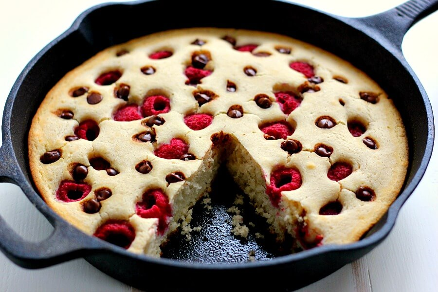 Fluffy, light and bursting with fresh raspberries and chocolate chips, this Baked Raspberry Chocolate Chip Pancake uses Krusteaz's Buttermilk Pancake Mix and is ready in less than thirty minutes. It's sweet enough to eat on its own or sprinkled with some powdered sugar or syrup!