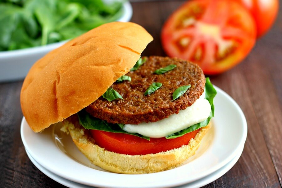 These Caprese Veggie Burgers are jam-packed with flavor and topped with tomatoes, basil, and mozzarella cheese. If you love anything filled with caprese ingredients, then these burgers were made for you!