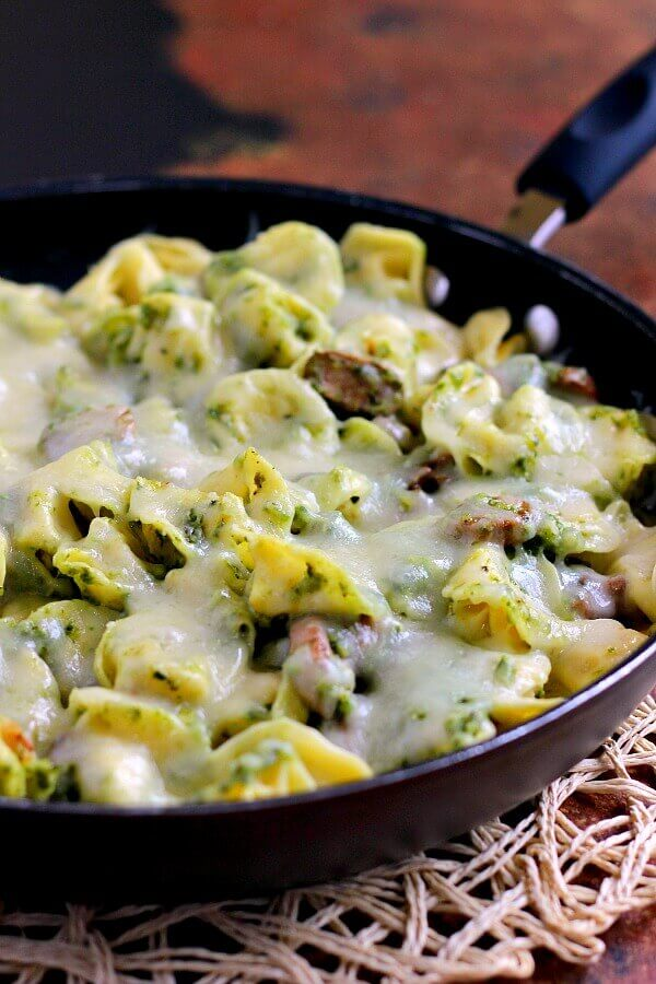 This Pesto Tortellini Bake is filled with fresh pasta, tangy pesto sauce, juicy mushrooms, and mozzarella cheese. It easy to prepare and makes the perfect weeknight meal!