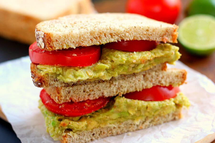 This Smashed Chickpea and Avocado Sandwich is loaded with flavor and makes a light and healthy lunch or dinner. Chickpeas and avocados make the perfect pair when blended with a touch of spice and lime juice!