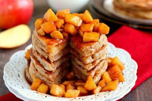 apple cinnamon pancakes with a slice cut out