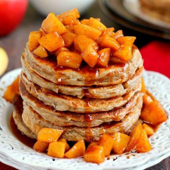 pancakes with apple cinnamon topping on a white plate