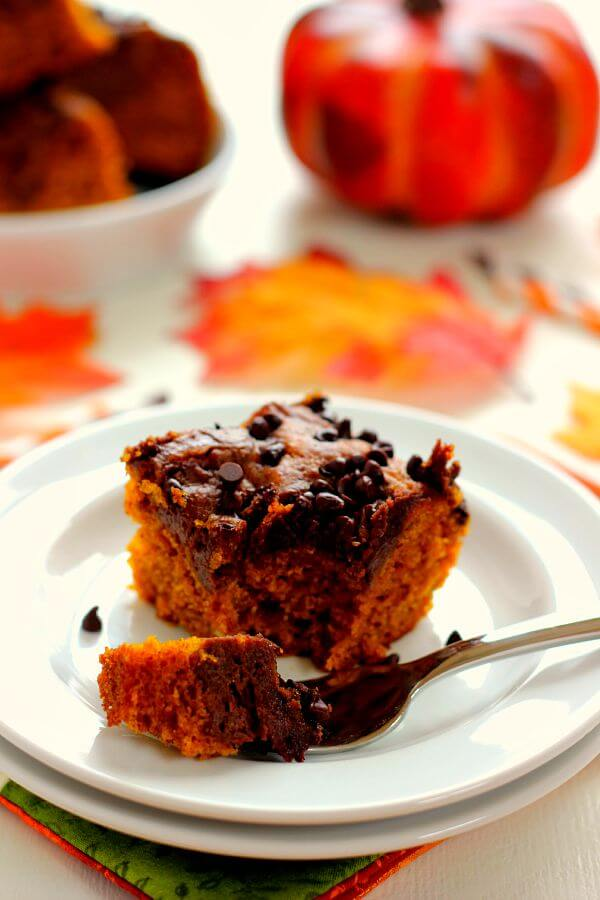 These Chocolate-Swirled Pumpkin Bars are soft, moist, and bursting with flavor. The pumpkin cake is filled with hints of cinnamon and spices and swirled with a chocolate cream cheese mixture! #pumpkin #pumpkinbars #pumpkinbarrecipe #pumpkincake #pumpkincakerecipe #creamcheesefrosting #chocolatefrosting #chocolatecreamcheesefrosting #pumpkinrecipe #falldessert #fallrecipe #falldessertrecipe