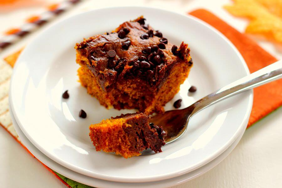 These Chocolate-Swirled Pumpkin Bars are soft, moist, and bursting with flavor. The pumpkin cake is filled with hints of cinnamon and spices and swirled with a chocolate cream cheese mixture!