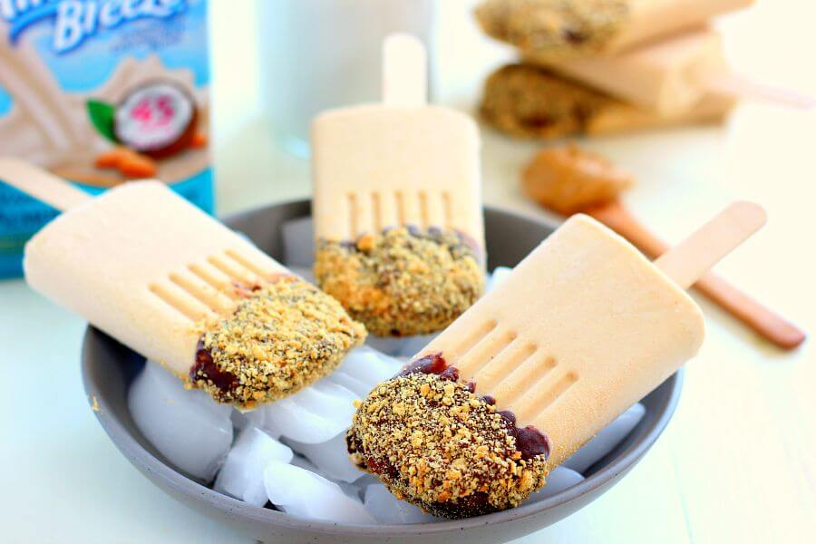 Packed with nutritious ingredients and ready in minutes, these pops are a version of the classic pie, in healthy form. Greek yogurt, Almond Breeze Almondmilk Coconutmilk Vanilla Unsweetened, peanut butter, and honey makes these pops suitable for breakfast, a mid-morning snack, or even as a healthy dessert!