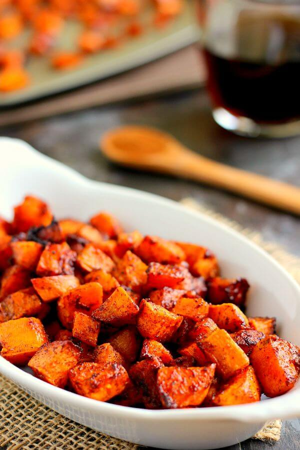 These Roasted Maple Cinnamon Sweet Potatoes are seasoned with cozy flavors and roasted to perfection until crispy on the outside and soft on the inside! #sweetpotatoes #roastedsweetpotatoes #maplesweetpotatoes #cinnamonsweetpotatoes #sidedish #easysidedish #potatoes #recipe