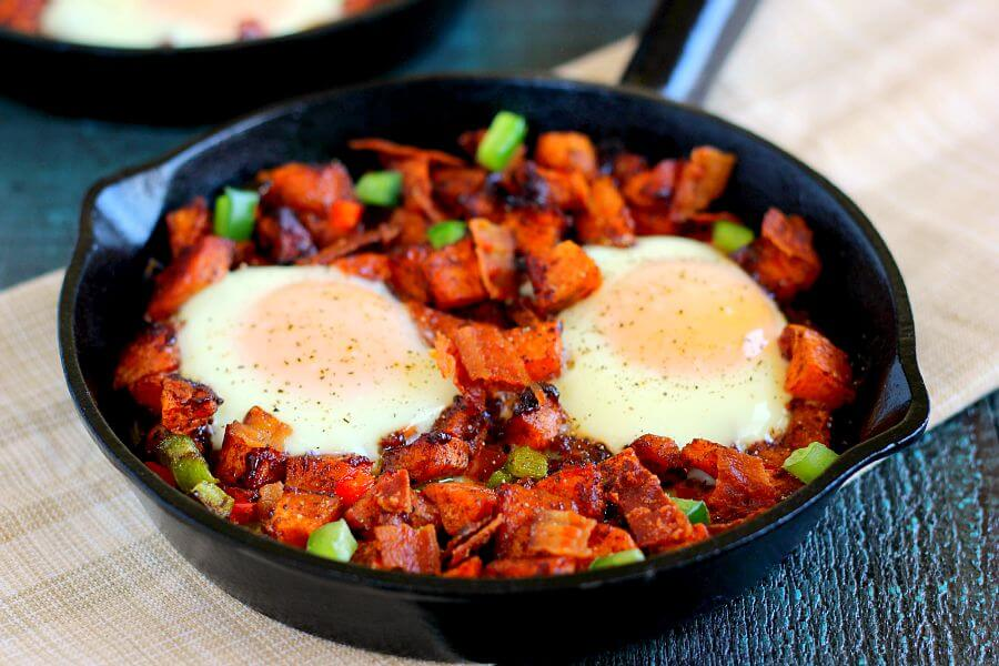 Packed with roasted maple sweet potatoes, fresh eggs, peppers, and bacon, this Roasted Maple Sweet Potato Breakfast Skillet comes together in minutes and makes a hearty breakfast. It's easy to prepare and full of cozy flavors that are perfect on those cool, fall mornings!