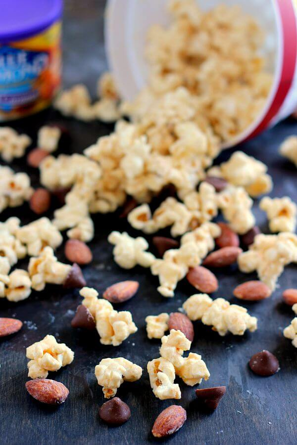 Jam-packed with peanut butter popcorn and filled with Blue Diamond Salted Caramel Almonds, this Salted Caramel Peanut Butter Popcorn is a little sweet, a little salty, and the perfect treat to munch on when your cravings strike!