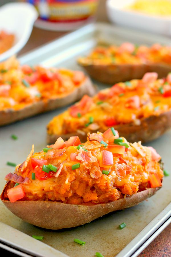 These Loaded Twice Baked Sweet Potatoes make the perfect side dish for any meal. The sweet potatoes are packed with with a brown sugar and cinnamon filling and then topped with cheese, crispy bacon, and sour cream. It's filled with flavor and the perfect fall dish for when you want something warm and comforting!