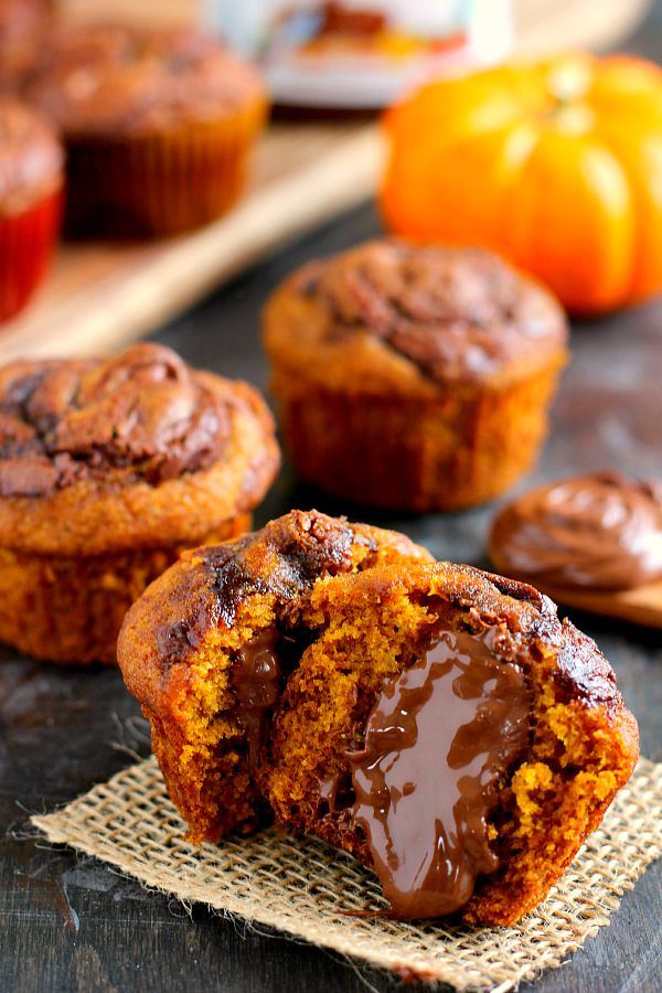 These Pumpkin Nutella Muffins are bursting with sweet pumpkin, cozy fall flavors, and swirled with creamy Nutella. They're easy to whip up and ready in less than a half hour. If you're a Nutella and pumpkin lover, these muffins are the perfect treat for you!