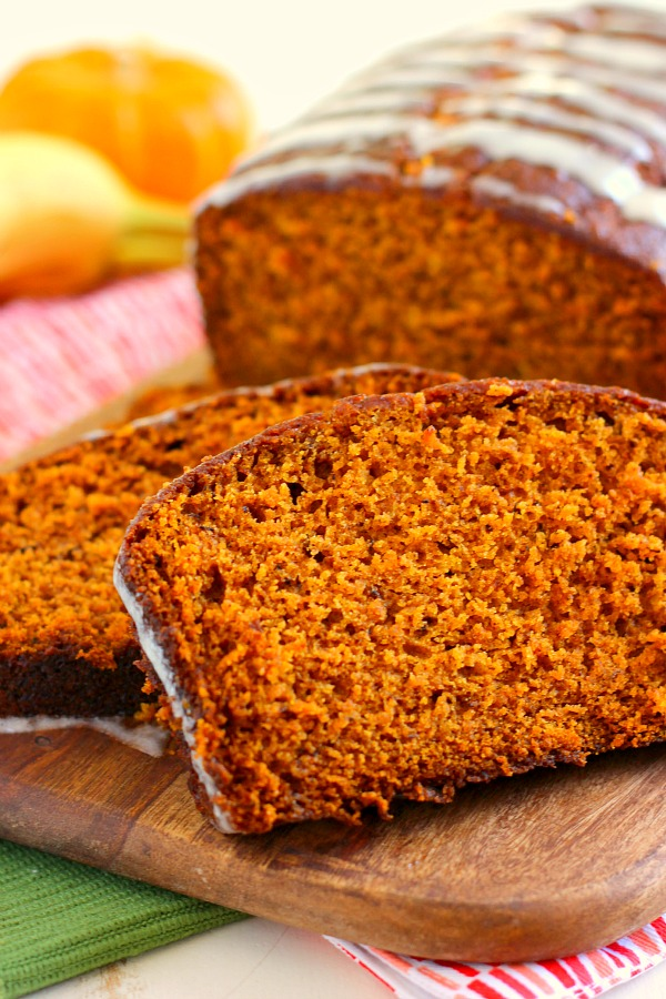 This Honey Glazed Pumpkin Banana Bread combines the classic fall flavor of pumpkin, swirled with hints of banana, and then topped with a sweet honey glaze. This bread is soft, moist, and bursting with just the right amount of flavor. One bite and this is sure to be your new fall favorite! #bananabread #bananabreadrecipe #pumpkinbread #pumpkinbananabread #falldesserts #fallbreakfastideas #fallbreakfasts #recipe