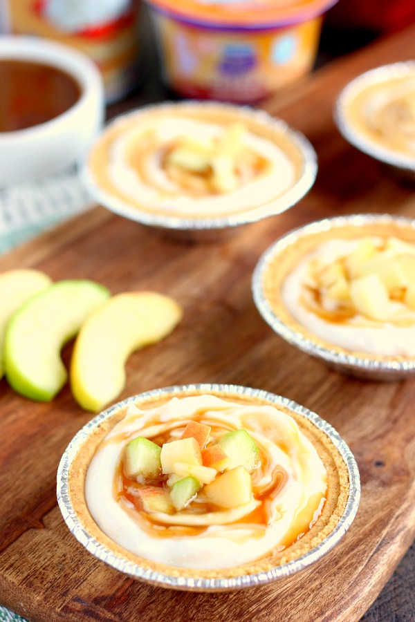 With just a few simple ingredients, these Mini Caramel Apple Yogurt Pies come together in no time and serve as a healthier treat. Filled with sweet yogurt, fresh apple chunks, and a cinnamon swirl, these pies make the perfect fall dessert! #yogurt #yogurtrecipes #caramelapplerecipes #healthybreakfast #healthyrecipes #fallrecipes