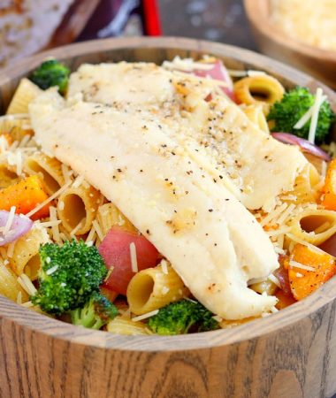 This Tilapia with Roasted Vegetable Pasta features tender rigatoni that is lightly seasoned and filled with fresh, roasted vegetables and topped with flaky tilapia. It's a gourmet meal that can be prepped and ready to eat in just 25 minutes!