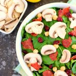 This Cranberry Mushroom Spinach Salad with Lemon Basil Vinaigrette combines baby spinach leaves, dried cranberries, fresh mushrooms, chickpeas, and crumbled bacon, all tossed with a lemon basil dressing. This dish is easy to throw together and serves as the perfect lunch or dinner!