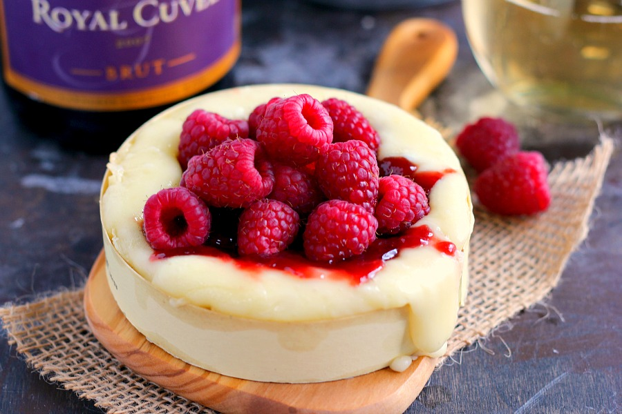 This Raspberry Baked Brie is sweet, savory, and perfect for entertaining during the holiday season. It makes an easy and impressive appetizer with minimal prep time. Pair it with a bottle of Gloria Ferrer wine and your holiday appetizer is guaranteed to be the hit of any party!