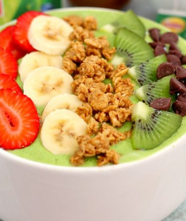 This Banana Kiwi Green Smoothie Bowl is the perfect way to jump start your mornings. Filled with bananas, kiwi, mango and spinach, this healthy bowl is packed with protein and nutrition. You can eat your morning smoothie and start out the day in a delicious way!