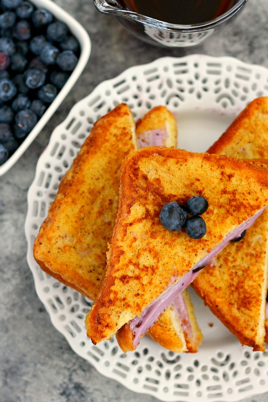 This Blueberry Cheesecake Stuffed French Toast is filled with a sweet cream cheese mixture and then baked until golden. It's simple to prepare and makes an indulgent breakfast that will wow your taste buds!