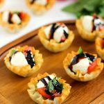 These Caprese Cups are a delicious bite-sized appetizer that will be the hit of your next party! Filled with cherry tomatoes, mozzarella cheese, fresh basil and a drizzle of balsamic glaze, these bites are easy to make and even better to eat!