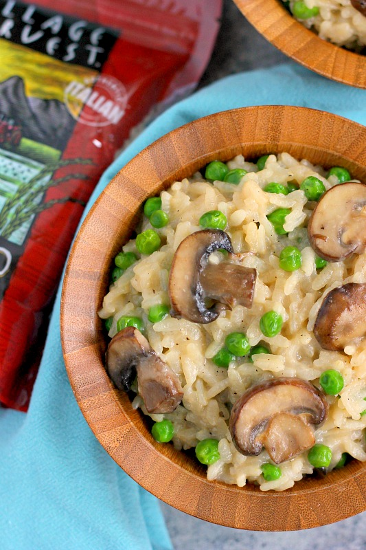 These Creamy Parmesan, Mushroom and Pea Risotto Bowls are filled with nourishing ingredients for an easy and healthier meal. Packed with Parmesan cheese, fresh mushrooms and peas, these bowls provide comfort food at its finest!