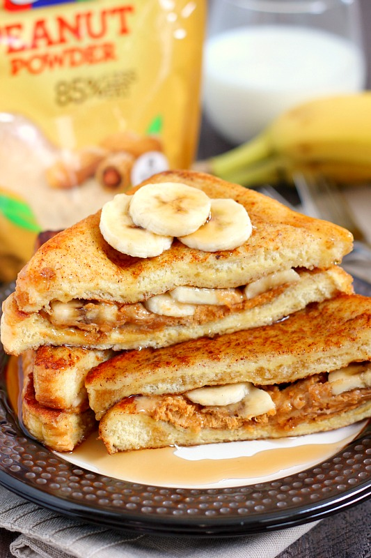 This Peanut Butter and Banana French Toast features thick slices of bread, drenched in a cinnamon mixture and topped with creamy Jif Peanut Powder and fresh banana slices. The French toast bakes up crisp and golden on the outside and fluffy on the inside. It also makes an easy breakfast that's packed with protein!