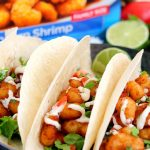 These Cilantro Lime Popcorn Shrimp Tacos are filled with crispy popcorn shrimp, a zesty cilantro lime sauce, and topped with a cilantro cream drizzle. Easy to make and ready in just 20 minutes, this flavorful dish will be the hit of your dinner table!